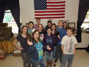 Left to right: Shawna (hand on hip), Kylee S. (light blue shirt/red lanyard),   Nicole (very front in light blue and glasses), Wyatt (far back in striped shirt), Kylee H. (black shirt and headband), Dakota (front, in purple hoodie), Janelle (back row, black shirt, no smile), Justice (black shirt in middle/long dark hair), Cole (light blue shirt/red hair), Sarah (back row, far right), Mikey (front row, white shirt)