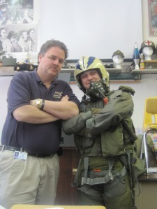Stephen and student - a guest speaker that was a Navy F-4 pilot dressed the student up in the his flight gear- the kids LOVED it!