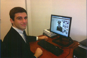 "Faces Never Forgotten Program Coordinator, George DeCastro works to asses the quality of each photo submitted to VVMF. Once it is assigned a grade of ""poor, fair, or good,"" it is displayed on VVMF's Virtual Wall of Faces. DeCastro also monitors the content for thousands of remembrances posted every month."