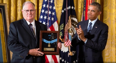 Dr. William Sloat accepts the Medal of Honor award on behalf of his brother, Don Sloat, from President Obama