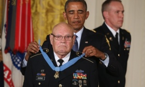 Barack Obama presents retired Bennie G Adkins with the Medal of Honor. Photograph: Mark Wilson/Getty Images