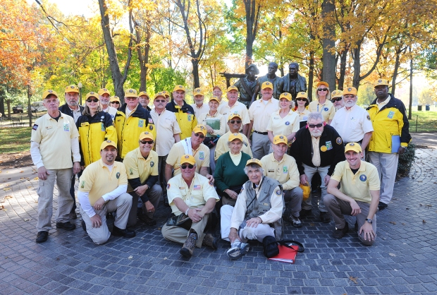 A group shot of volunteers of The Vietnam Veterans Memorial in front of The Three Servicemen Statue. Veterans Day, 2014.