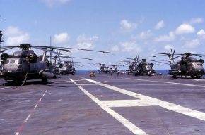 U.S. Air Force Sikorsky HH-53C Super Jolly Green Giant helicopters on the deck of the aircraft carrier USS Midway (CV-41) during en:Operation Frequent Wind, April 1975.