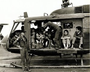 South Vietnamese Huey & refugees.