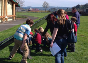 Local students tour the Wall That Heals in Rainier City Park.