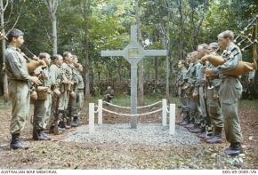 LONG TAN, SOUTH VIETNAM. 1969-08-18. THE PIPERS' LAMENT FOR THE DEAD OF LONG TAN. A POIGNANT MOMENT AT THE COMMEMORATIVE SERVICE HELD ON THE SITE OF THE BATTLE OF LONG TAN, FOUGHT IN 1966 BY D COMPANY, 6TH BATTALION, THE ROYAL AUSTRALIAN REGIMENT (6 RAR).  © Australian War Memorial